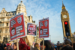 Demonstrators gather in Parliament Square to protest against planned increases in tuition fees and maintenance grant cuts in Central London Britain 9th December 2010.
