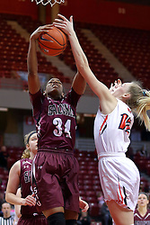 29 January 2017: Nicole Martin and Millie Stevens reach for a rebound during an College Missouri Valley Conference Women's Basketball game between Illinois State University Redbirds the Salukis of Southern Illinois at Redbird Arena in Normal Illinois.