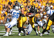 September 4 2010: Iowa Hawkeyes running back Adam Robinson (32) runs through a hole during the first quarter of the NCAA football game between the Eastern Illinois Panthers and the Iowa Hawkeyes at Kinnick Stadium in Iowa City, Iowa on Saturday September 4, 2010. Iowa defeated Eastern Illinois 37-7.