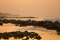 Sunset above the rocky shore