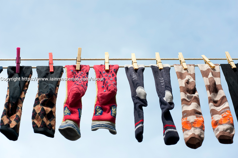 Row of socks drying on washing line in Burano Itlay