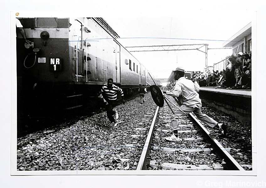 Copy of a vintage print by Joao Silva. Train attack, Soweto.