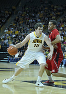 January 26, 2012: Iowa Hawkeyes guard Matt Gatens (5) drives on Nebraska Cornhuskers guard Toney McCray (0) during the NCAA basketball game between the Nebraska Cornhuskers and the Iowa Hawkeyes at Carver-Hawkeye Arena in Iowa City, Iowa on Thursday, January 26, 2012.