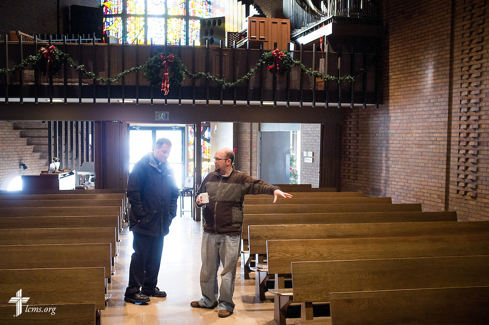 The Rev. Daniel Burhop explains to the Rev. Michael W. Meyer, manager of LCMS Disaster Response, the water damage from the leaking roof in the sanctuary of University Lutheran Chapel on Wednesday, Jan. 8, 2014, in Boulder, Colo. LCMS Communications/Erik M. Lunsford