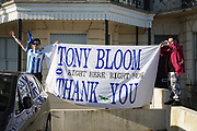 Fans with Tony Bloom flag during the Brighton & Hove Albion Football Club Promotion Parade at Brighton Seafront, Brighton, East Sussex. United Kingdom on 14 May 2017. Photo by Ellie Hoad.