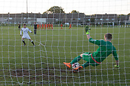 St John's Lennon Mitchell saves during the penalty shoot out - Grove (white) v. St.John's (tangerine) in the U17 George Grant Memorial Trophy Final (sponsored by DFCSS) at Whitton Park, Dundee, Photo: David Young<br /> <br />  - &copy; David Young - www.davidyoungphoto.co.uk - email: davidyoungphoto@gmail.com