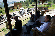 riders relax at a Montana ghost town