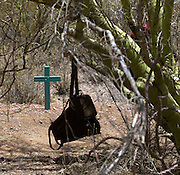 The backpacks of Adilene Lopez Moreno, 11, and her mother, Rita Moreno Ocampo, of San Martin, Oaxaca, Mexico, remain at the site where the girl succumbed to heat exhaustion on June 14, 2002, on the Tohono O'odham Reservation, Nolia, Arizona, USA.