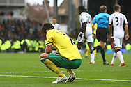 Picture by Paul Chesterton/Focus Images Ltd.  07904 640267.31/03/12.Russell Martin of Norwich is dejected at the end of the Barclays Premier League match at Craven Cottage stadium, London.