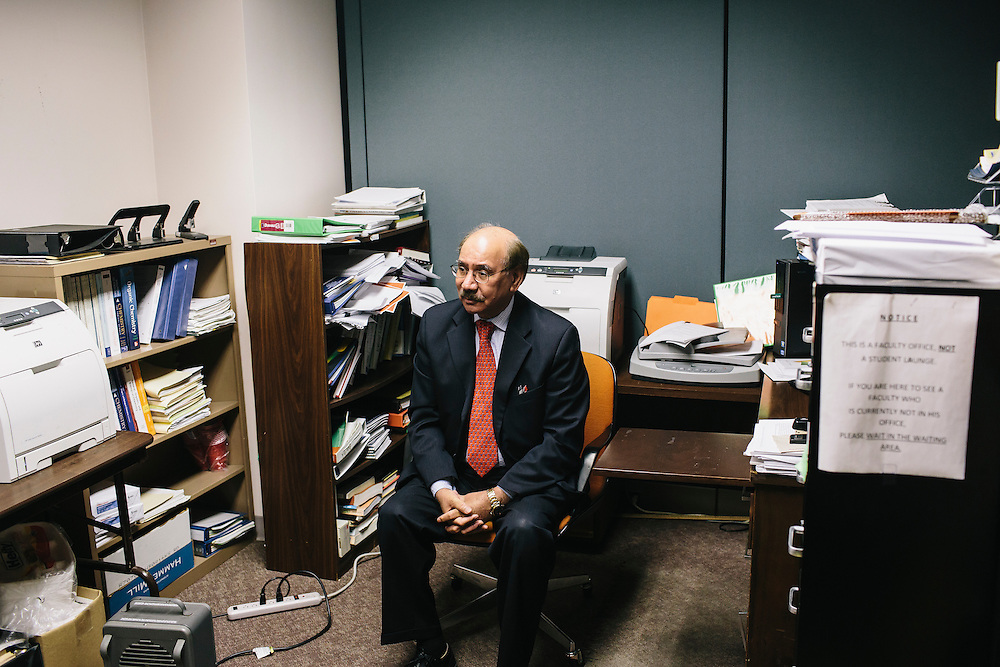 Dr. Daryao Khatri, a physics and computer science professor at UDC, waits in his office for Marc Davis, a former student who Khatri has mentored into a teaching position at Woodrow Wilson High School.