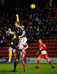 Bristol City Defender Aden Flint (ENG) and Leyton Orient Goalkeeper Shwan Jalal (ENG) compete in the air - Photo mandatory by-line: Rogan Thomson/JMP - 07966 386802 - 11/02/2014 - SPORT - FOOTBALL - The Matchroom Stadium, London - Leyton Orient v Bristol City - Sky Bet Football League 1.