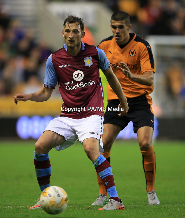 Aston Villa's Libor Kozak (left) holds off challenge from Wolverhampton Wanderers' Conor Coady during the pre-season friendly at Molineux, Wolverhampton.