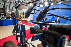 Mari Kiviniemi, Finland's prime minister speaks to the media as he departs, following the conclusion of the EU Summit, at the European Council headquarters in Brussels, Belgium on Friday, Dec. 14, 2012. (Photo © Jock Fistick)