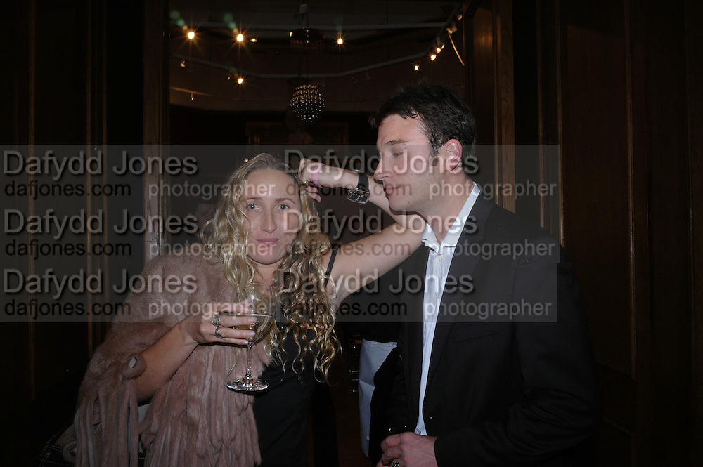 Amelia Troubridge and Guy Davies. 4 Inches, A  Photographic Auction in aid of the Elton John Aids Foundation hosted by Tamara Mellon and Arnaud Bamberger. Christie's. 8 King St. London. 25 May 2005. ONE TIME USE ONLY - DO NOT ARCHIVE  © Copyright Photograph by Dafydd Jones 66 Stockwell Park Rd. London SW9 0DA Tel 020 7733 0108 www.dafjones.com