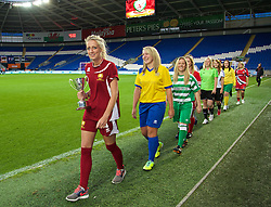 CARDIFF, WALES - Tuesday, August 21, 2014: Players from each of the twelve Welsh Women's Premier League teams parade the trophy during the FIFA Women's World Cup Canada 2015 Qualifying Group 6 match at the Cardiff City Stadium. (Pic by David Rawcliffe/Propaganda)