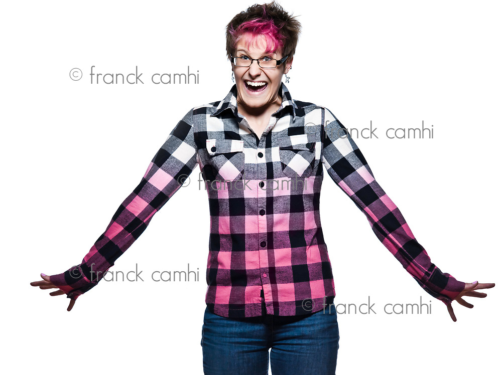 Portrait of a young expressive excited woman laughing in studio on white isolated background
