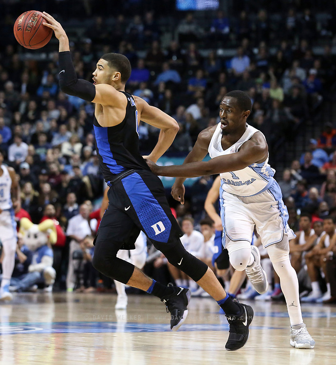 Duke forward Jayson Tatum (0) grabs the ball and runs past North Carolina forward Theo Pinson (1) during the semifinals of the 2017 New York Life ACC Tournament at the Barclays Center in Brooklyn, N.Y., Friday, March 10, 2017. (Photo by David Welker, theACC.com)