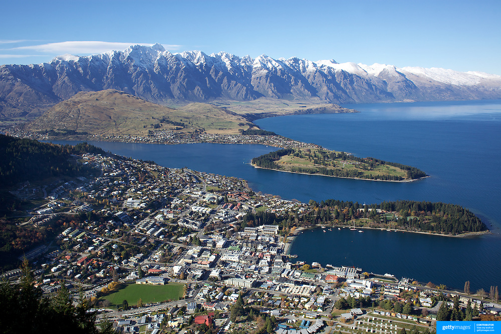 A view of Queenstown, New Zealand with the snow capped Remarkables mountain range providing a stunning backdrop..Queenstown is nestled on the shores of the crystal clear waters of Lake Wakatipu in the Central Otago region of the South Island of New Zealand..Queenstown is New Zealand's premier tourist destination providing an abundance of year round outdoor activities for both young and old. Queenstown, Central Otago, South Island, New Zealand. 18th May 2011. Photo Tim Clayton..