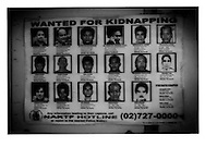 Wanted kidnappers posted in lightrail station, Manila, Philippines.  Kidnapping is a huge problem for the upper class business community, especially among ethnic Chinese Filipinos.  Kidnappers often deal cruelly with their victims and many are murdered.