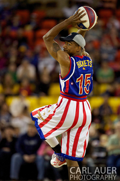April 30th, 2010 - Anchorage, Alaska:  Time out for a little game of Harlem Globetrotter baseball as Buckets Blakes (15) gets set to pitch to Hi-Lite Bruton.