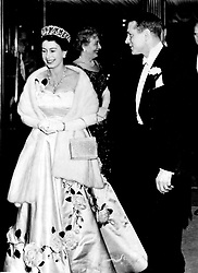 Queen Elizabeth II with Sir Laurence Olivier, producer, director and star of 'Richard III' which Her Majesty was arriving to see at the Leicester Square Theatre at the film's premiere. This is Sir Laurence's third Shakesperian presentation and the Queen was seeing it at her own request.