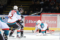 KELOWNA, CANADA - FEBRUARY 18:  Adam Brown #1 of the Kelowna Rockets makes a save against the Red Deer Rebels at the Kelowna Rockets on February 18, 2012 at Prospera Place in Kelowna, British Columbia, Canada (Photo by Marissa Baecker/Shoot the Breeze) *** Local Caption ***