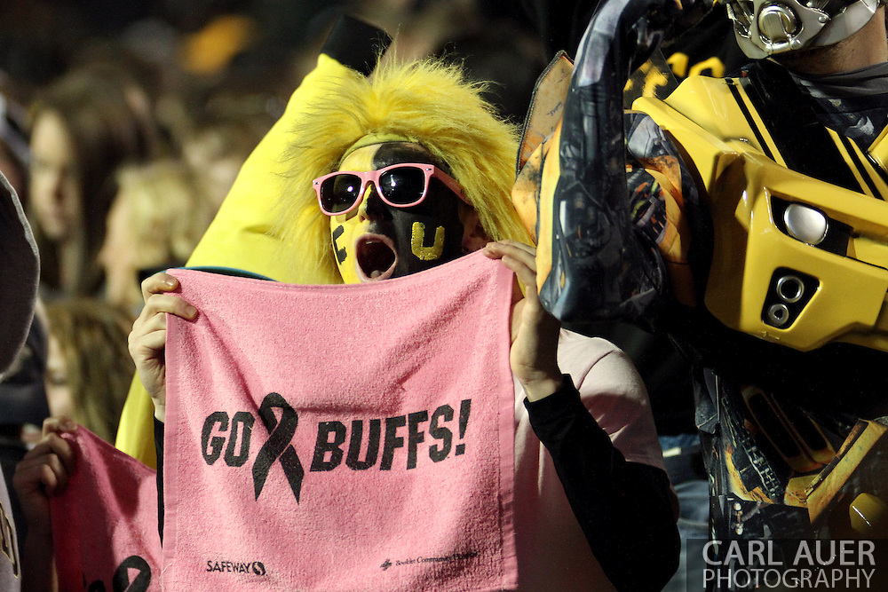 October 26th, 2013:  Buff Hair (Colorado student John Grotenhuis) cheers on the Buffaloes in the second half of the NCAA football game between the University of Arizona Wildcats and the University of Colorado Buffaloes at Folsom Field in Boulder, Colorado