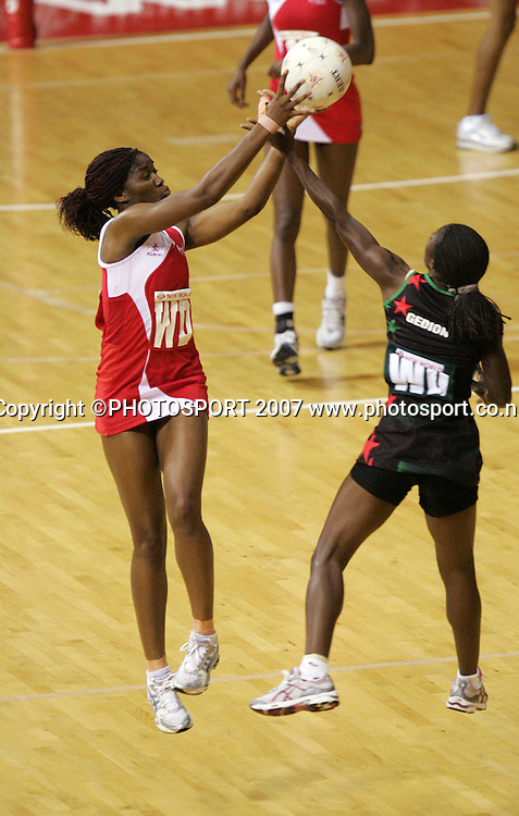 England's Sonia Mkoloma (L) and Malawi's Melenia Gedison. England v Malawi. Netball World Championships. Trusts Stadium, Auckland, New Zealand. Thursday 15 November 2007. Photo: Hagen Hopkins/PHOTOSPORT