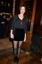 Actress ANNE HATHAWAY at a party to celebrate the launch of the Maison Assouline Flagship Store at 196a Piccadilly, London on 28th October 2014.  During the evening Valentino signed copies of his new book - At The Emperor's Table.
