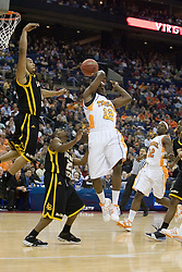 Tennessee Volunteers guard Ramar Smith (12) delivers a no look pass against Long Beach State.  The #5 seed Tennessee Volunteers defeated the #12 seed Long Beach State 49ers 121-86  in the first round of the Men's NCAA Tournament in Columbus, OH on March 16, 2007.