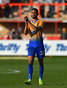 CJ Hamilton (22) of Mansfield Town applauds the fans at full time after the 4-1 win over Exeter City during the EFL Sky Bet League 2 match between Exeter City and Mansfield Town at St James' Park, Exeter, England on 30 March 2019.