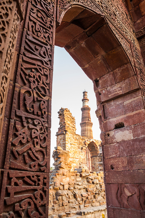 The ruins of Qutb complex with Qutb Minar in the background, Delhi, India.
