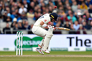 Rory Burns of England ducks under a bouncer from Pat Cummins of Australia during the International Test Match 2019, fourth test, day three match between England and Australia at Old Trafford, Manchester, England on 6 September 2019.