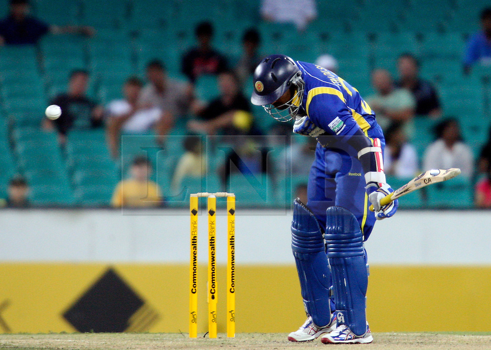 © Licensed to London News Pictures. 17/02/2012. Sydney Cricket Ground, Australia. Tillakaratne Dilshan feels his chest after being hit by the ball after a quick Brett Lee delivery during the One Day International cricket match between Australia Vs Sri Lanka. Photo credit : Asanka Brendon Ratnayake/LNP