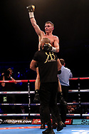 Ryan Burnett celebrates Zhanat Zhakiyanov after their IBF and WBA Super World Bantamweight Championship bout at the SSE Arena, Belfast.
