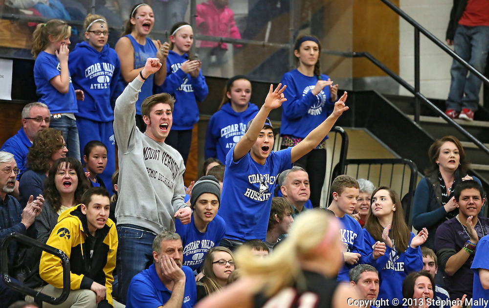 Cedar Valley Christian fans cheer during the Class 1A Regional Quarterfinals girl's basketball game between Cedar Valley Christian and Lisbon at Lone Tree High School in Lone Tree on Tuesday, February 12 2013. Lisbon defeated Cedar Valley Christian 39-32. (Stephen Mally/Freelance)