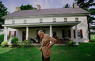 De Nard Kirk, 86, is shown behind his house, Aug. 26, 1997, in Buckingham Twp., Pa. He is donating 60 acres of the 266 year old farm to the Bucks County Heritage Conservancy. (Photo by William Thomas Cain)