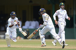 July 7, 2018 - Colombo, Western Province, Sri Lanka - Sri Lanka Borad Xl batsman Kaushal silva (L) and Dhanajaya De Silva (R) taking a quick single during the day one of a two-day practice match between the Sri Lanka Board XI and South African team at P Sara Oval grounds in Colombo on 7th July, 2018, South Africa will play two Test matches, five ODI's and one T20 match in Sri Lanka. The first Test will play on July 12 at the Galle International Cricket Stadium in Galle. (Credit Image: © Sameera Peiris/Pacific Press via ZUMA Wire)