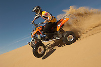 Man riding quad bike in desert close up