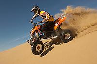 Man riding quad bike in desert close up
