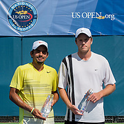 August 16, 2014, New Haven, CT:<br /> Sanam Singh and Jeff Dadamo pose for a photograph with the trophies after playing each other in the 2014 US Open National Playoffs Men's final on day four of the 2014 Connecticut Open at the Yale University Tennis Center in New Haven, Connecticut Monday, August 18, 2014.<br /> (Photo by Billie Weiss/Connecticut Open)