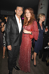 MR COLIN RADCLIFFE and model ANGELA DUNN at a party to celebrate the launch of the Boodles Wonderland jewellery collection held at the Haymarket Hotel, 1 Suffolk Place, London on 9th June 2008.<br /><br />NON EXCLUSIVE - WORLD RIGHTS