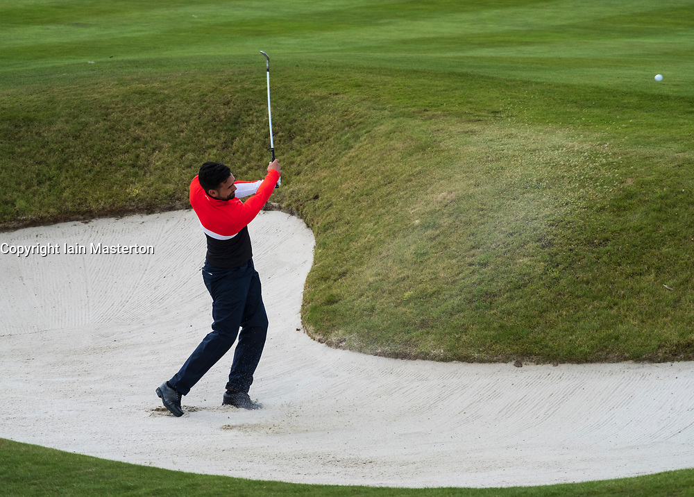 Gleneagles, Scotland, UK; 8 August, 2018.  European Championships 2018. Day one of golf competition at Gleneagles..Men's and Women's Team Championships Round Robin Group Stage - 1st Round. Four Ball Match Play format. Lee Slattery of Great Britain 1 plays out of bunker on the 18th hole. Match against Spain 2 was halved.