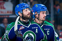REGINA, SK - MAY 23: Giorgio Estephan #29 and Glenn Gawdin #15 of the Swift Current Broncos react to their last WHL career game with a loss to the Regina Pats at the Brandt Centre on May 23, 2018 in Regina, Canada. (Photo by Marissa Baecker/CHL Images)