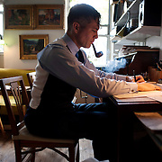 May 10, 2012 - Brooklyn, NY : Musician and composer Michael Arenella transcribes a 1928 recording of 'My Sweeter Than Sweet,' as performed by Victor Lopez and his orchestra, in his apartment on Douglas Street in Brooklyn on Thursday. He painstakingly writes out the music by hand as he listens to it  CREDIT : Karsten Moran for The New York Times