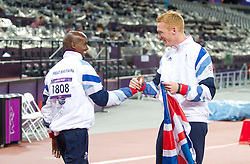 © Licensed to London News Pictures. 04/08/2012. London,BritainGold medalists Mo Farah and Greg Rutherford pose at the Olympic Stadium, in London, during the London 2012 Olympic Games.  Photo credit : Bogdan Maran/LNP/BPA