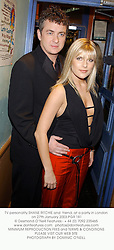 TV personality SHANE RITCHIE and  friend, at a party in London on 27th January 2003.			PGR 181