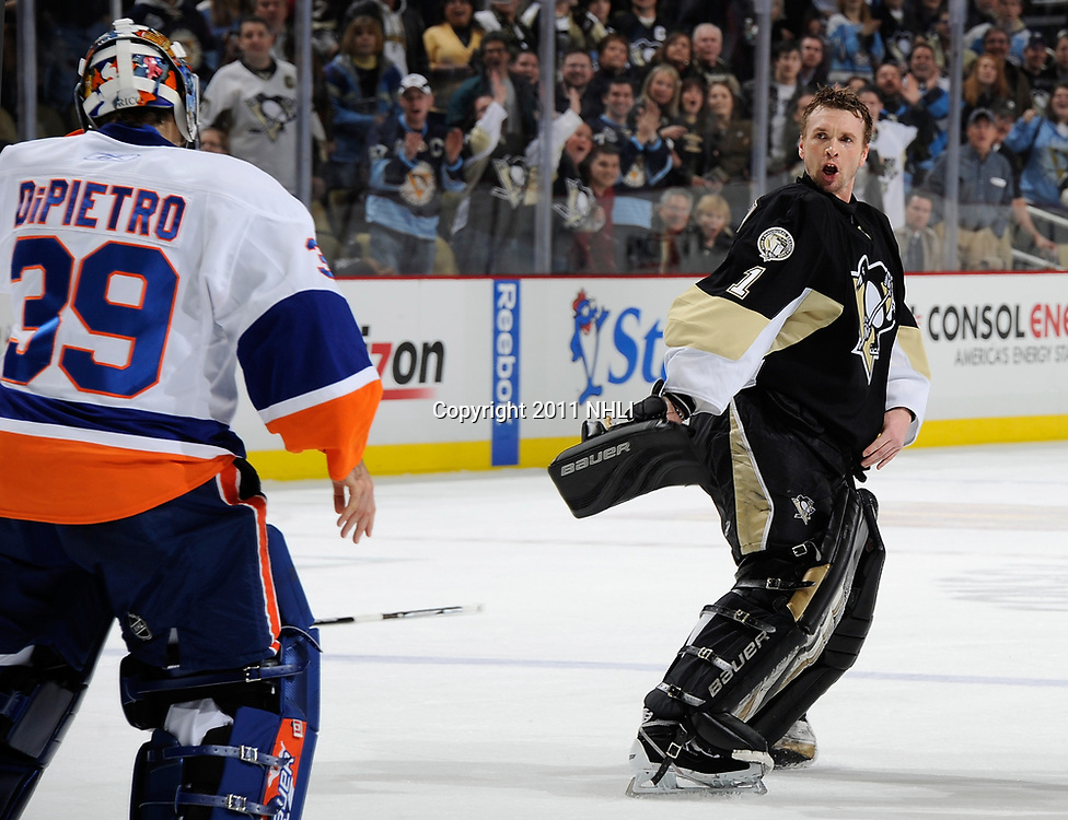 PITTSBURGH - FEBRUARY 02:  Brent Johnson #1 of the Pittsburgh Penguins drops his gloves against Rick DiPietro #39 of the New York Islanders on February 2, 2011 at Consol Energy Center in Pittsburgh, Pennsylvania. Pittsburgh won the game 3-0. (Photo by Joe Sargent/NHLI via Getty Images) *** Local Caption *** Brent Johnson; Rick DiPietro