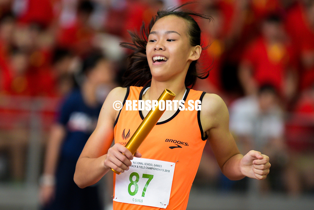 Samantha Theresa Ortega (#87) of Singapore Sports School crosses the finishing line first to win the C Division girls' 4x100m relay race. (Photo © Eileen Chew/Red Sports)