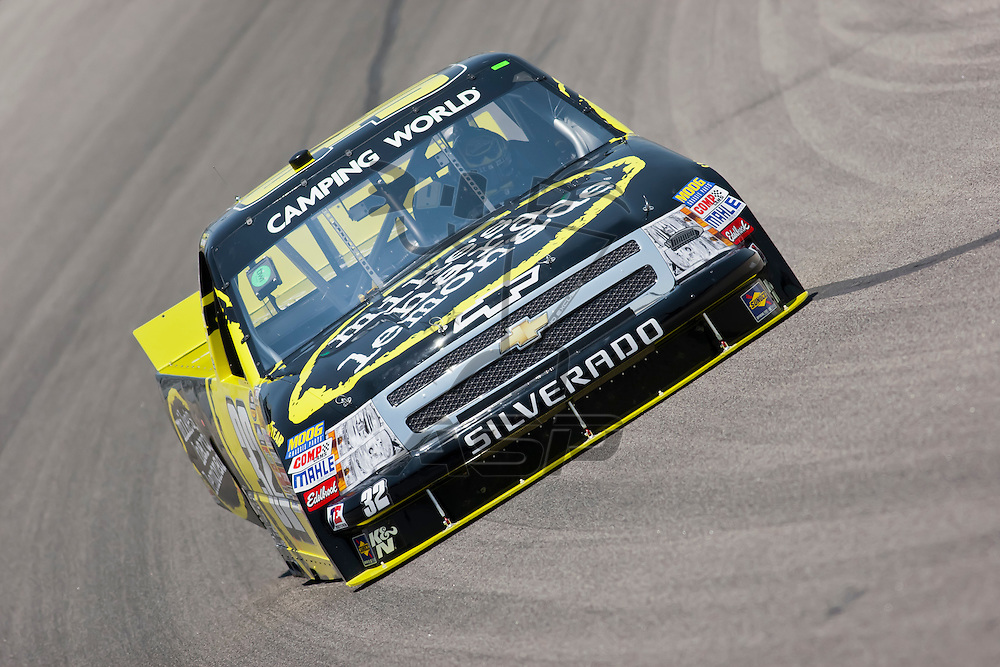 Fort Worth, TX - June 09, 2011:  Brad Sweet (32) brings his Camping World Truck Series truck through the turns during a practice session for the WinStar World Casino 400 race in Fort Worth, TX.